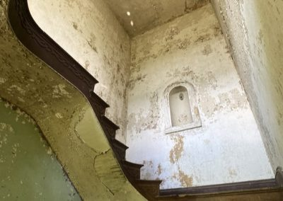 abandoned victorian mansion staircase