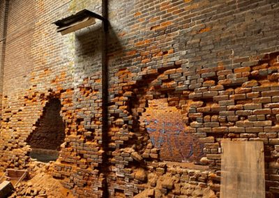 brick-walls-caving-in-with-holes