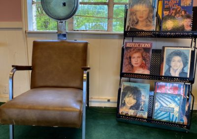 abandoned hair salon dryer chair with magazine rack