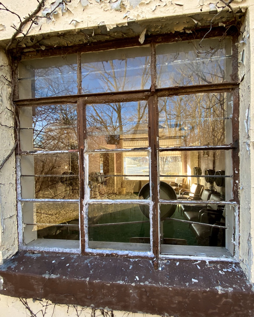 Looking Inside A Window Into An Abandoned Hair Salon