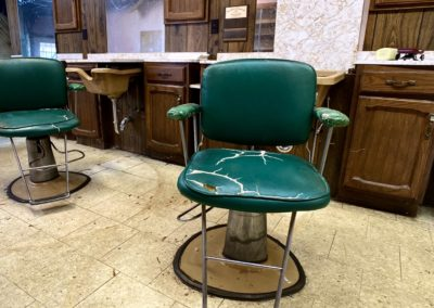 abandoned green barber shop chairs
