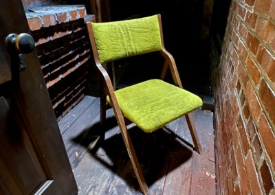 creepy bright green chair in the dark