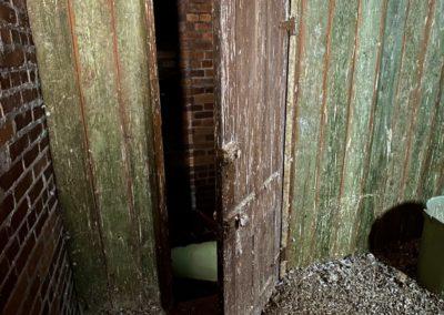 green door into church bell tower