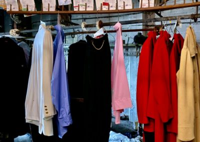clothes still hanging at abandoned dry cleaner