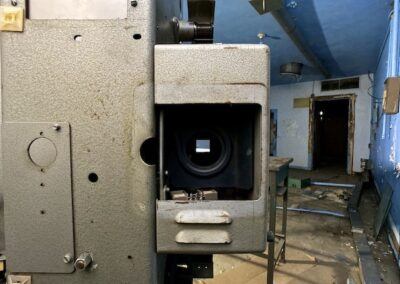 abandoned-vintage-35mm-theater-projector-blue-walls