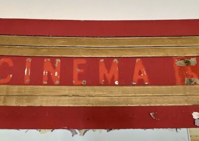 abandoned-theater-red-gold-cinema-sign