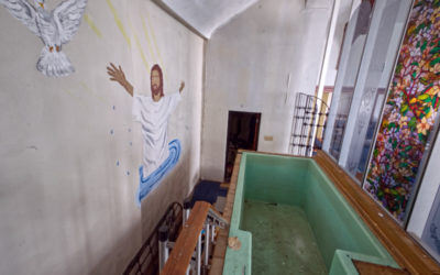 Full Immersion Baptism in an Abandoned Church