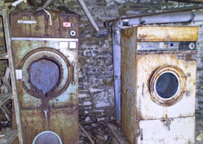 abandoned laundry in basement of a mansion