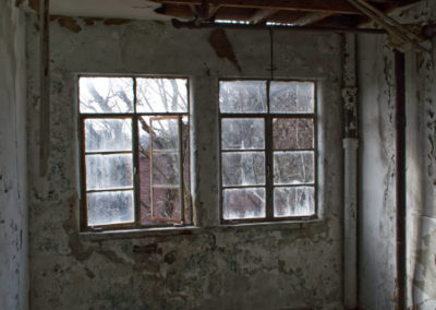 steel frame windows in abandoned apartment building