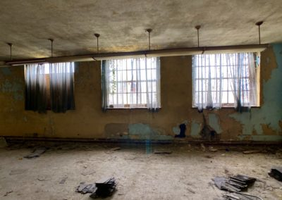 abandoned school basement room with curtains