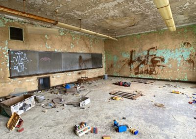 abandoned 1920s school with chalk boards