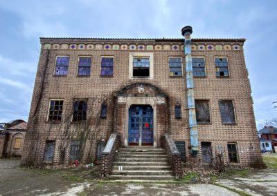 abandoned 1920s catholic school cloudy background