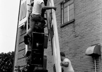 fairborn-theater-sign-installation-men-working