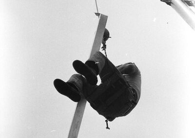 man-swinging-from-crane-1940s