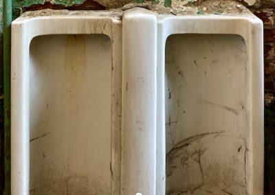 vintage-urinals-dayton-green-walls